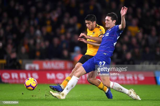 Raul Jimenez of Wolverhampton Wanderers scores his team's first goal under pressure from Andreas Christiansen of Chelsea during the Premier League...