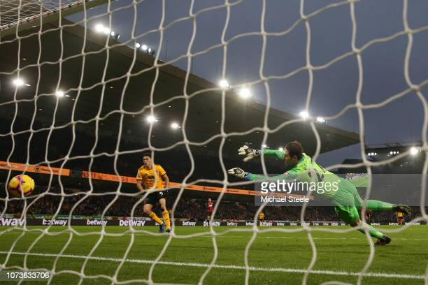 Raul Jimenez of Wolverhampton Wanderers scores his team's first goal during the Premier League match between Wolverhampton Wanderers and AFC...