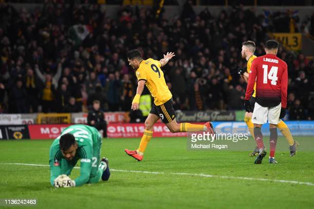 Raul Jimenez of Wolverhampton Wanderers scores his team's first goal during the FA Cup Quarter Final match between Wolverhampton Wanderers and...