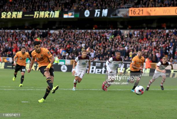 Raul Jimenez of Wolverhampton Wanderers scores his team's first goal from the penalty spot during the Premier League match between Wolverhampton...