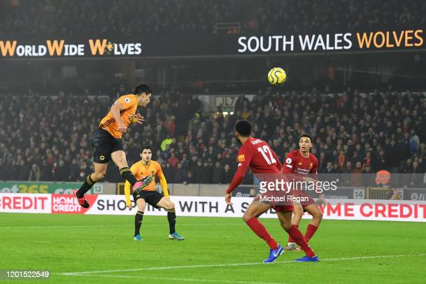 Raul Jimenez of Wolverhampton Wanderers scores his team's first goal during the Premier League match between Wolverhampton Wanderers and Liverpool FC...