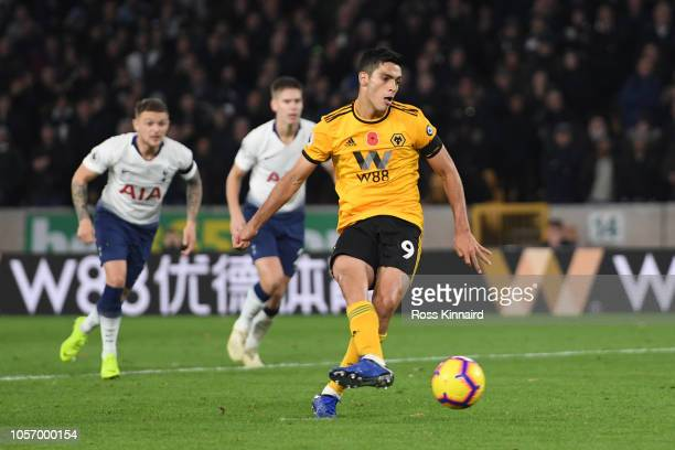 Raul Jimenez of Wolverhampton Wanderers scores his team's second goal from the penalty spot during the Premier League match between Wolverhampton...