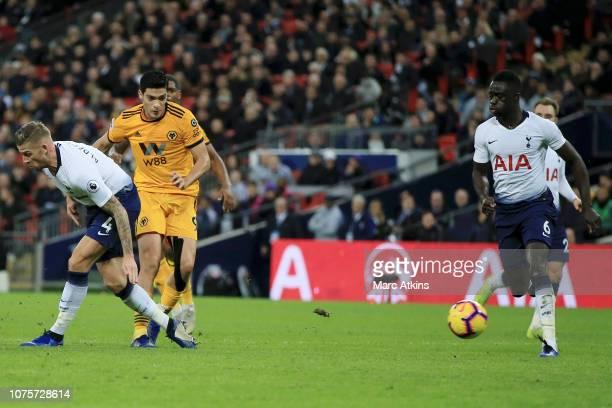 Raul Jimenez of Wolverhampton Wanderers scores his team's second goal past Toby Alderweireld of Tottenham Hotspur and Davinson Sanchez of Tottenham...