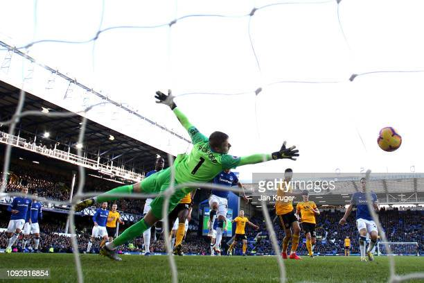Raul Jimenez of Wolverhampton Wanderers scores his team's second goal during the Premier League match between Everton FC and Wolverhampton Wanderers...