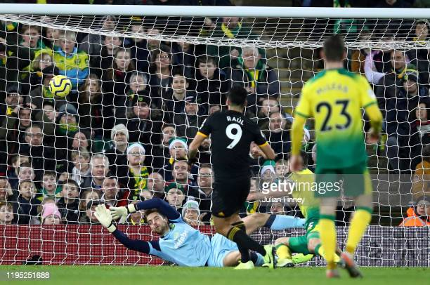 Raul Jimenez of Wolverhampton Wanderers scores his team's second goal during the Premier League match between Norwich City and Wolverhampton...