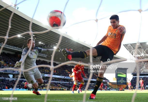 Raul Jimenez of Wolverhampton Wanderers scores his team's third goal past Tim Krul of Norwich City during the Premier League match between...