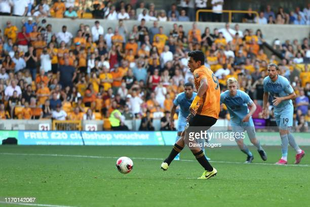 Raul Jimenez of Wolverhampton Wanderers scores lastminute penalty equalizer during the Premier League match between Wolverhampton Wanderers and...