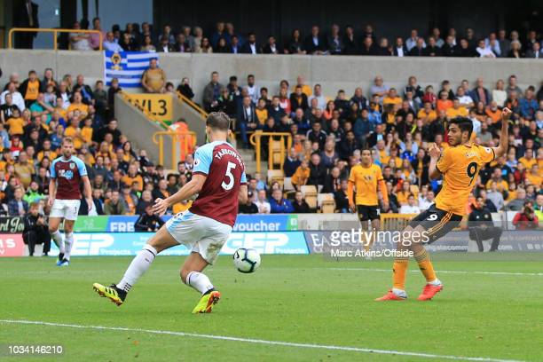 Raul Jimenez of Wolverhampton Wanderers scores the opening goal during the Premier League match between Wolverhampton Wanderers and Burnley FC at...