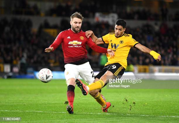 Raul Jimenez of Wolverhampton Wanderers shoots past Luke Shaw of Manchester United during the FA Cup Quarter Final match between Wolverhampton...