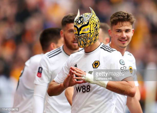 Raul Jimenez of Wolverhampton Wanderers wears a mask as he celebrates scoring his team's second goal during the FA Cup Semi Final match between...