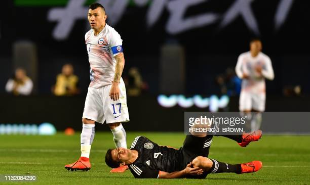 Raul Jiminez of Mexico reacts after colliding with Gary Medel of Chile during the international friendly match between Mexico and Chile at SDCCU...
