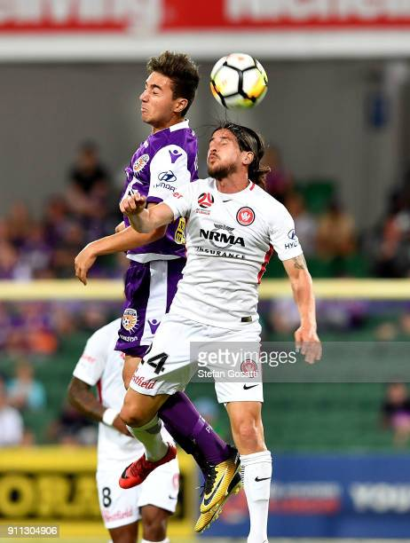Raul Llorente of the Wanderers and Jacob Italiano of the Glory contest the ball during the round 18 ALeague match between the Perth Glory and the...