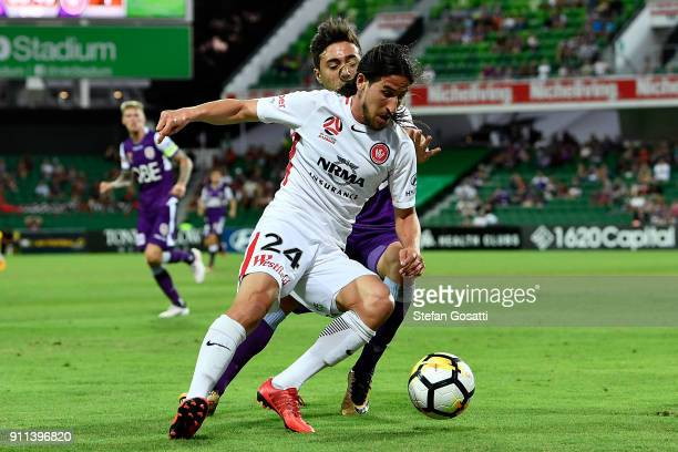 Raul Llorente of the Wanderers competes for the ball against Jacob Italiano of the Glory during the round 18 ALeague match between the Perth Glory...