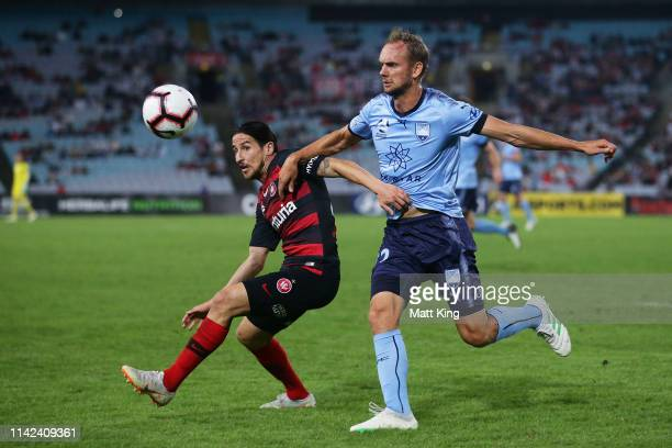 Raul Llorente of the Wanderers competes for the ball against Siem De Jong of Sydney FC during the round 25 A-League match between the Western Sydney...