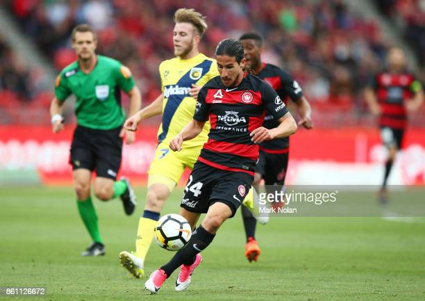 Raul Llorente of the Wanderers in action during the round two ALeague match between the Western Sydney Wanderers and the Central Coast Mariners at...