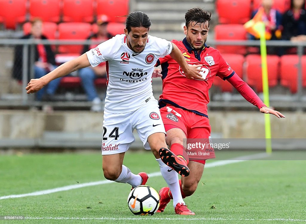 Raul Llorente of West Sydney Wanderers and Nikola Mileusnic of Adelaide United during the round eight A-League match between Adelaide United and the Western Sydney Wanderers at Coopers Stadium on November 26, 2017 in Adelaide, Australia.