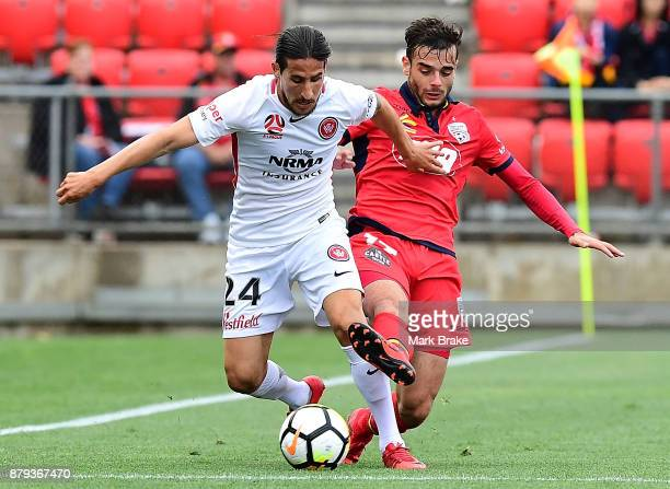 Raul Llorente of West Sydney Wanderers and Nikola Mileusnic of Adelaide United during the round eight ALeague match between Adelaide United and the...