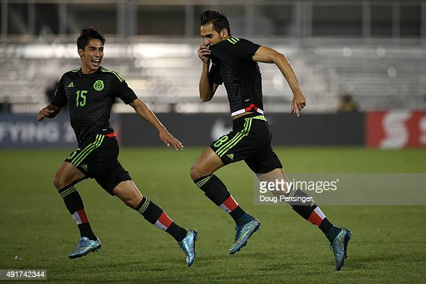 Raul Lopez of Mexico celebrates his goal in the fourth minute with Erick Aguirre of Mexico to take a 10 lead over Honduras during 2015 CONCACAF...