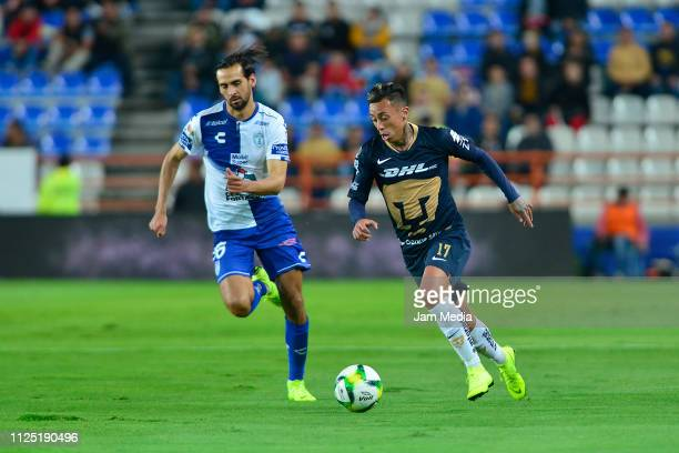 Raul Lopez of Pachuca fights for the ball with Martin Rodriguez of Pumas during the 4th round match between Pachuca and Pumas UNAM as part of the...