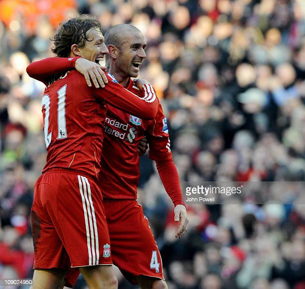 Raul Meireles celebrates his goal with Lucas of Liverpool during the Barclays Premier League match between Liverpool and Wigan Athletic at Anfield on...