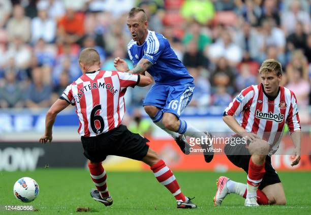 Raul Meireles of Chelsea is challenged by Lee Cattermole of Sunderland during the Barclays Premier League match between Sunderland and Chelsea at the...