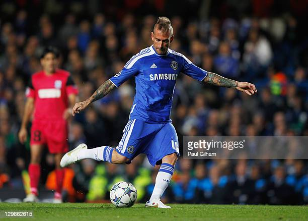 Raul Meireles of Chelsea scores their first goal during the UEFA Champions League group E match between Chelsea and Genk at Stamford Bridge on...