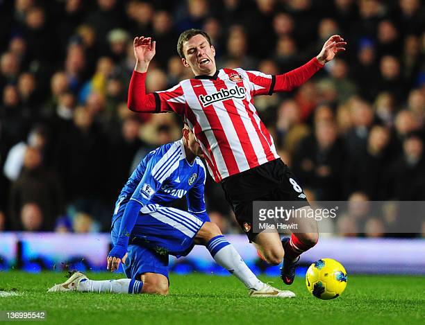 Raul Meireles of Chelsea trips Craig Gardner of Sunderland during the Barclays Premier League match between Chelsea and Sunderland at Stamford Bridge...
