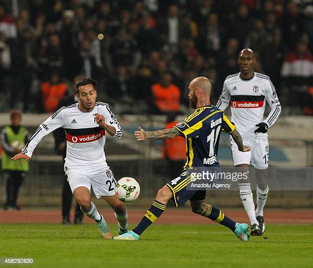 Raul Meireles of Fenerbahce vies with Kerim Frei of Besiktas during the Turkish Spor Toto Super League match between Besiktas and Fenerbahce at...
