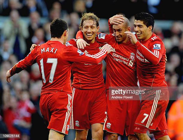 Raul Meireles of Liverpool celebrates his goal with the Liverpool team during the Barclays Premier League match between Liverpool and Wigan Athletic...
