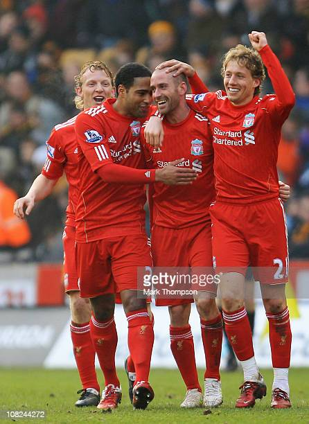 Raul Meireles of Liverpool celebrates his second goal with team mates Glen Johnson and Lucas during the Barclays Premier League match between...