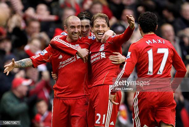 Raul Meireles of Liverpool celebrates scoring the opening goal with team mates Lucas Maxi Rodriguez and Fernando Torres during the Barclays Premier...