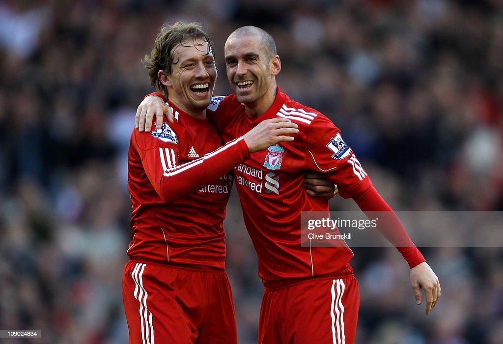Raul Meireles (R) of Liverpool celebrates scoring the opening goal with team mate Lucas during the Barclays Premier League match between Liverpool and Wigan Athletic at Anfield on February 12, 2011 in Liverpool, England.