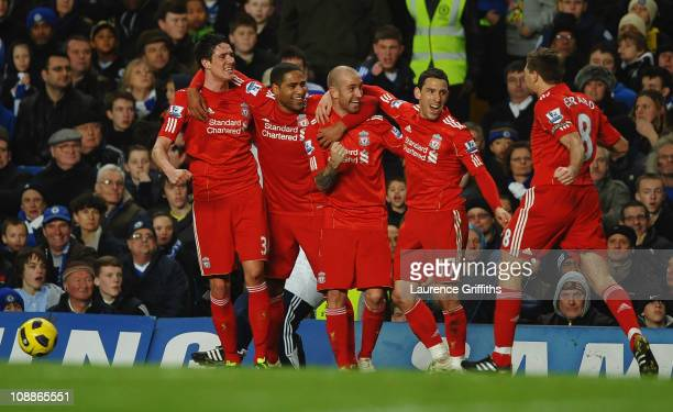Raul Meireles of Liverpool celebrates with teammates as he scores their first goal during the Barclays Premier League match between Chelsea and...
