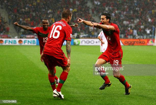 Raul Meireles of Portugal celebrates scoring the opening goal with team mate Tiago during the 2010 FIFA World Cup South Africa Group G match between...