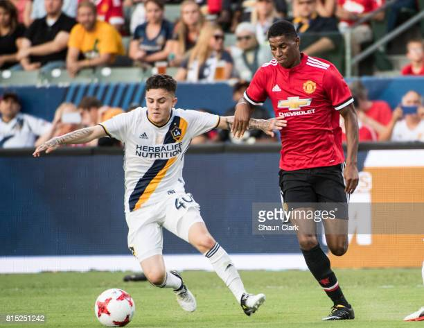 Raul Mendiola of Los Angeles Galaxy battles Marcus Rashford of Manchester United during the Los Angeles Galaxy's friendly match against Manchester...