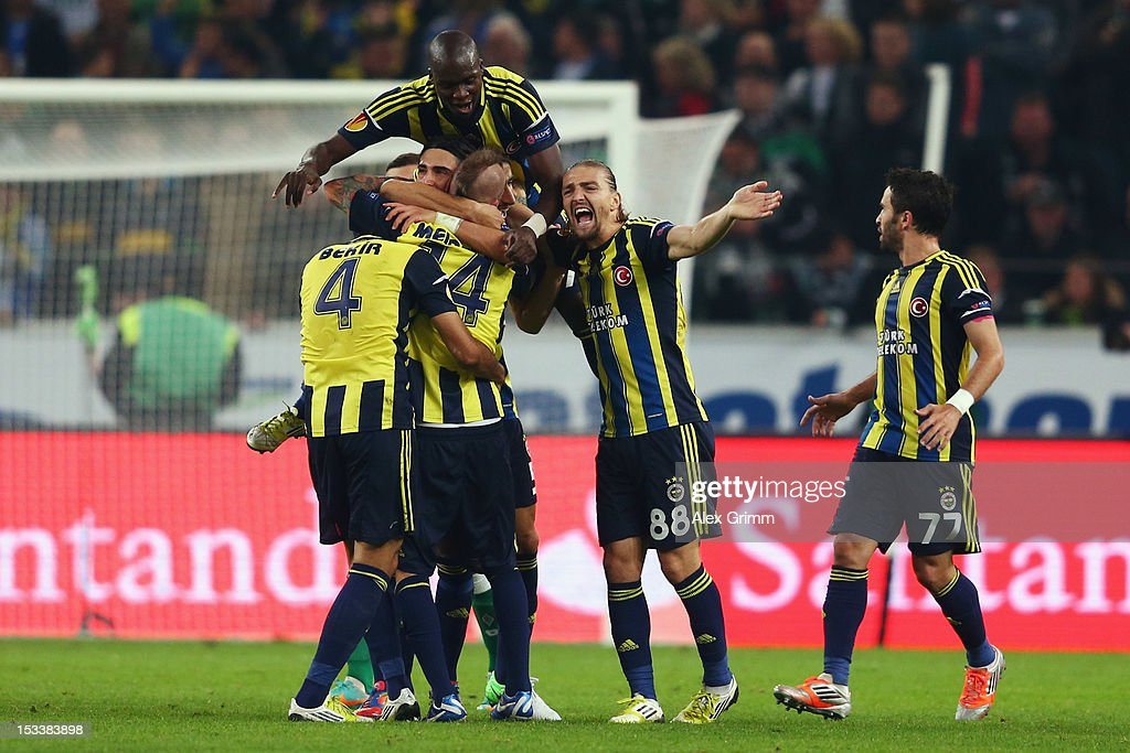 Raul Mereiles of Fenerbahce celebrates his team's second goal with team mates during the UEFA Europa League group C match between Borussia Moenchengladbach and Fenerbahce SK at Borussia-Park on October 4, 2012 in Moenchengladbach, Germany.