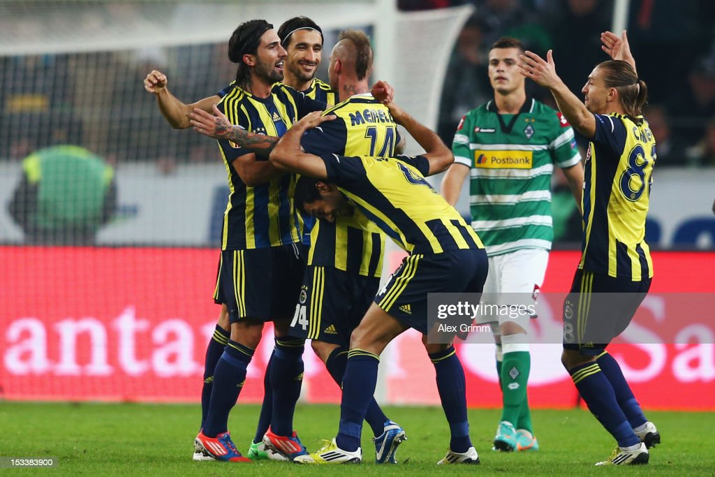 Raul Mereiles (C) of Fenerbahce celebrates his team's second goal with team mates during the UEFA Europa League group C match between Borussia Moenchengladbach and Fenerbahce SK at Borussia-Park on October 4, 2012 in Moenchengladbach, Germany.