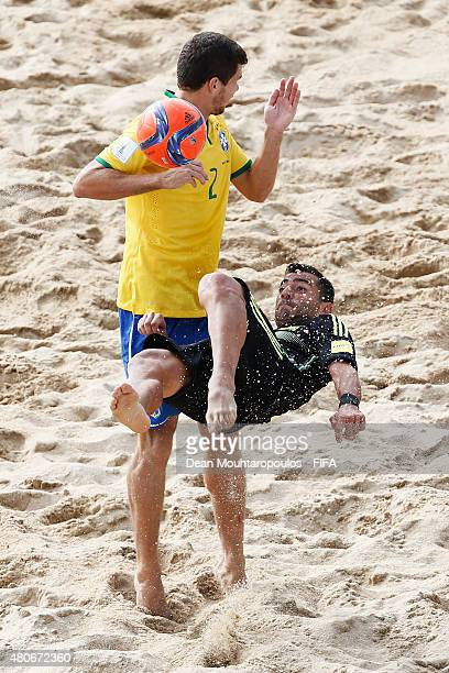 Raul Merida of Spain attempts a scissor kick shot on goal in front of Fernando Ddi of Brazil during the Group C FIFA Beach Soccer World Cup match...
