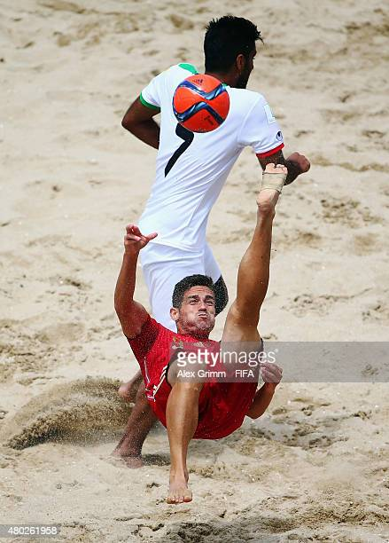 Raul Merida of Spain does a bicycle kick against Mehran Morshedi of Iran during the FIFA Beach Soccer World Cup Portugal 2015 Group C match between...