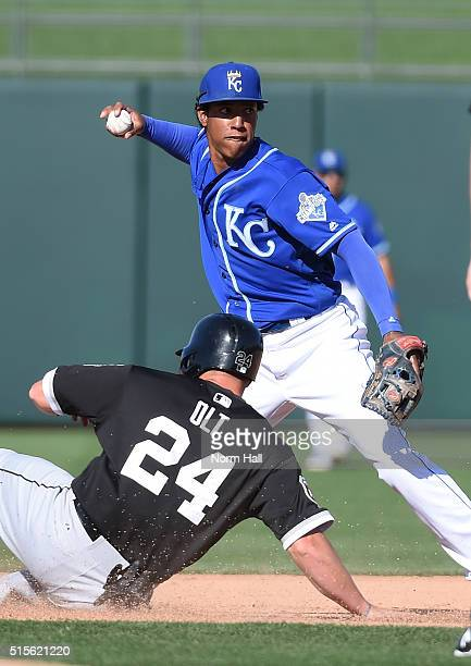 Raul Mondesi of the Kansas City Royals attempts to turn a double play during the ninth inning as Mike Olt of the Chicago White Sox is forced out...