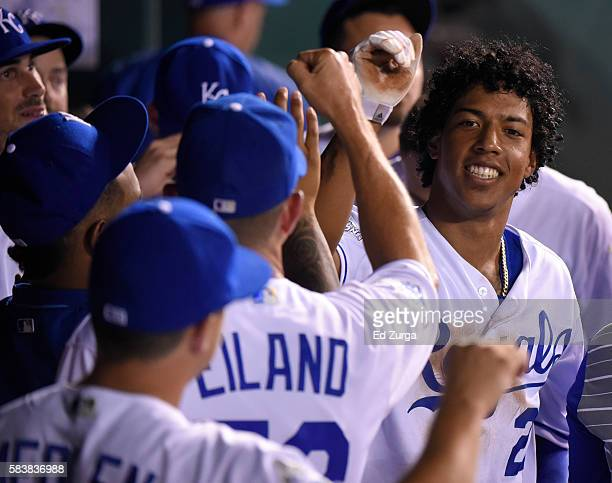 Raul Mondesi of the Kansas City Royals celebrates with teammates after scoring on a Jarrod Dyson triple in the seventh inning Los Angeles Angels of...
