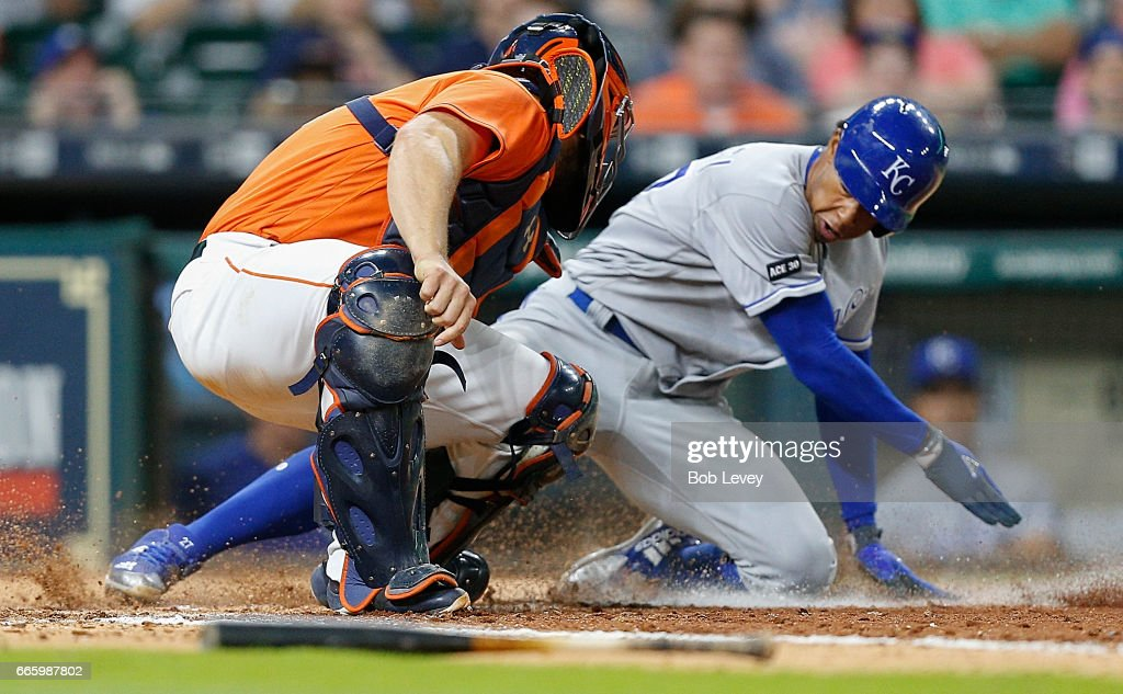 Raul Mondesi #27 of the Kansas City Royals is tagged out at home by Evan Gattis #11 of the Houston Astros in the seventh inning at Minute Maid Park on April 7, 2017 in Houston, Texas.