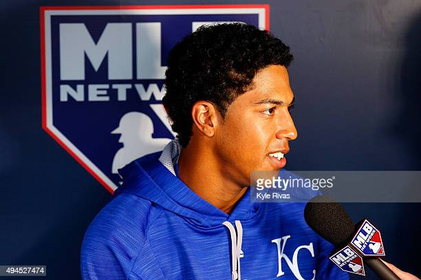 Raul Mondesi of the Kansas City Royals looks on from the dugout prior to Game One of the 2015 World Series against the New York Mets at Kauffman...