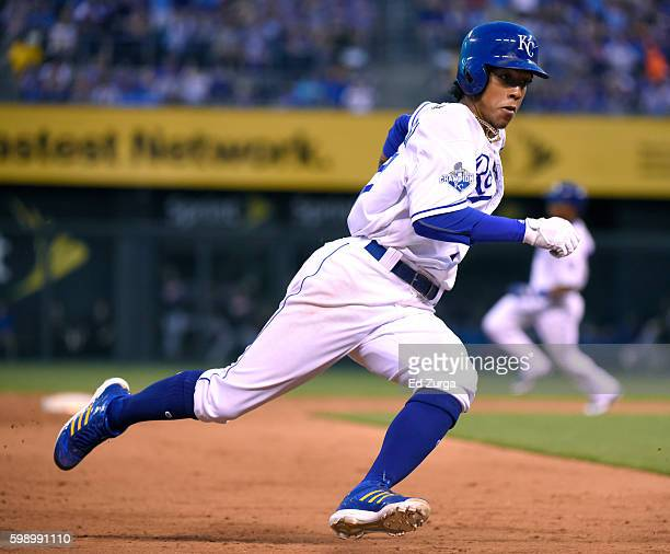Raul Mondesi of the Kansas City Royals rounds third as he heads home to score on a Cheslor Cuthbert single in the fifth inning against the Detroit...