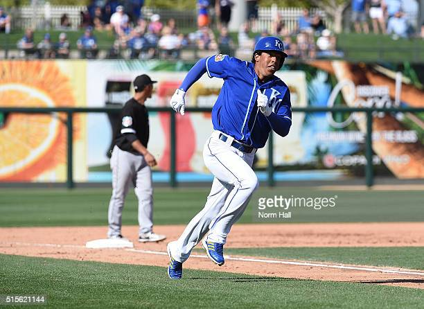 Raul Mondesi of the Kansas City Royals rounds third base and scores a run during the seventh inning against the Chicago White Sox at Surprise Stadium...