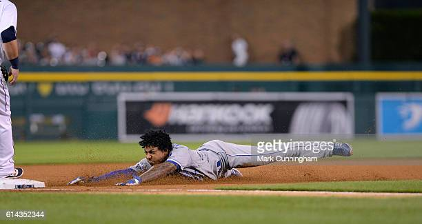 Raul Mondesi of the Kansas City Royals slides headfirst into third base during the game against the Detroit Tigers at Comerica Park on August 17 2016...