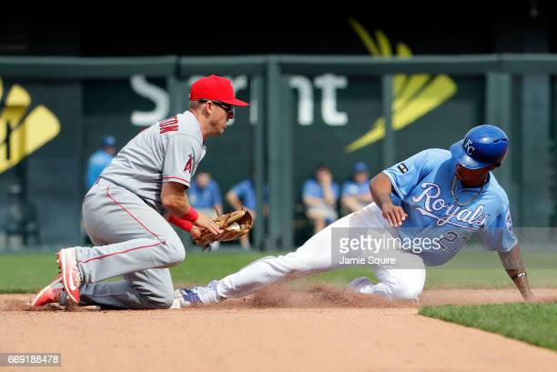Raul Mondesi of the Kansas City Royals slides safely into second base for a steal as Cliff Pennington of the Los Angeles Angels is late applying the...
