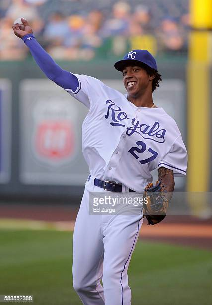 Raul Mondesi of the Kansas City Royals throws the ball as he warms up prior to a game against the Los Angeles Angels of Anaheim at Kauffman Stadium...