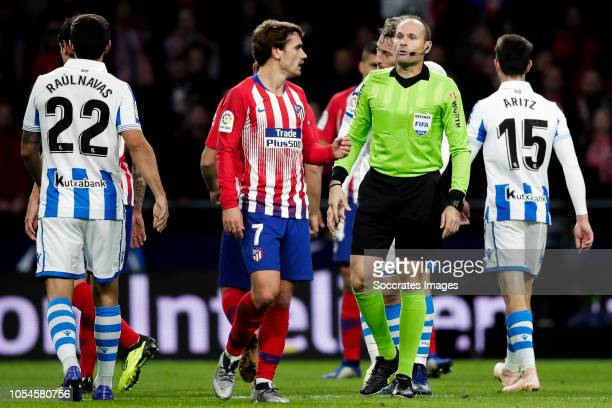 Raul Navas of Real Sociedad Antoine Griezmann of Atletico Madrid referee Mateu Lahoz Aritz Elustondo of Real Sociedad during the La Liga Santander...