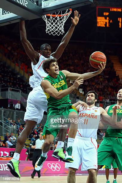 Raul Neto of Brazil goes to the hoop against Serge Ibaka of Spain during the Men's Basketball Preliminary Round match on Day 10 of the London 2012...